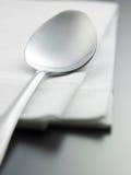 Napkin and spoon Stock Image