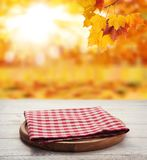 Napkin. Stack of colorful dish towels on wooden table and autumn background. Top view mock up royalty free stock image