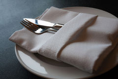 Napkin and utensils royalty free stock photography