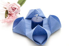 Napkin With Blue Candle Stock Photo