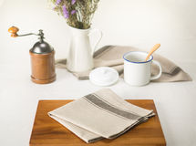 Napkin on wooden plates for breakfast. A cup of coffee on white table royalty free stock images