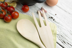 Napkin with a wooden spoon Stock Photography