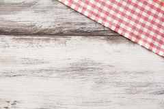 Napkin on wooden table Royalty Free Stock Photos