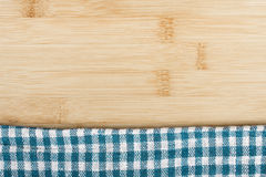 Napkin on wooden table Stock Images