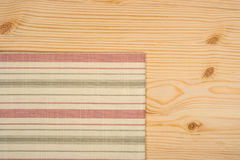 Napkin on wooden table Stock Photography