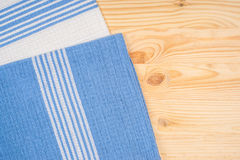 Napkin on wooden table Royalty Free Stock Photo