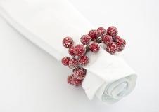 Napkin with xmas berry napking ring. White napkin with xmas berry napking ring Stock Image