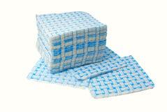 Napkins. Many blue paper napkins on a white background stock photos