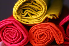 Napkins. Rolled stacked colorful linen napkins Royalty Free Stock Image