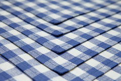 Napkins in blue cage lined background Stock Photos