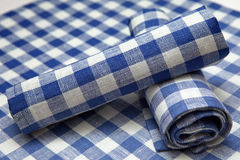 Napkins in blue square folded creatively Royalty Free Stock Image
