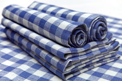 Napkins in blue square folded creatively. Linen napkins in blue cage folded creatively Royalty Free Stock Photo