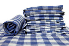 Napkins in blue square folded creatively Stock Images