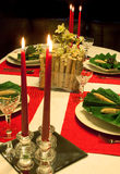 Napkins and candles. Festive holiday table with decorated napkins and flower arrangement stock image