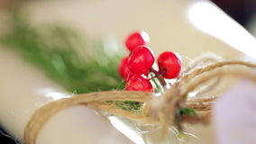 The napkins are decorated with fir and berries stock video