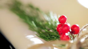 The napkins are decorated with fir and berries stock footage