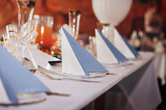 Napkins on the festive table. Empty glasses and napkin on festive table royalty free stock photography