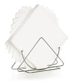 Napkins in a stand. Close-up isolated on a white background stock photography