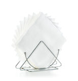Napkins in a stand close-up isolated on a white Royalty Free Stock Image