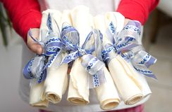 Napkins tied with ribbon. Entertaining - napkins tied with ribbon Royalty Free Stock Images