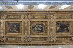 Naples; the Cathedral: the ceiling of the nave. Sumptuous ceiling with gilt wood and wide paintings stock image