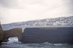 Naples coastline and a brick wall, Italy Stock Images