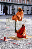 Naples,curiosity,illusionist,unreal,meditation,plebiscite. Performance of indian illusionist in plebiscite square. Generate a lot of curiosity in passersby Royalty Free Stock Photography
