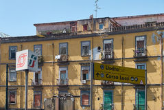 Building of Naples with Trenitalia and Circumvesuviana signboard in front. Royalty Free Stock Photo