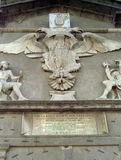 NAPLES, ITALY, 1988 - The coat of arms of Charles V in the frieze overlooking the portal of access to Castel dell`Ovo represents stock photos