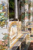 Colourful tiled pillars and bench in the cloister garden at the Santa Chiara Monastery in Via Santa Chiara, Naples Italy. Naples Italy. Colourful tiled pillars stock photography