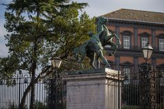 NAPLES, ITALY - 04 November, 2018.The entrance and the bronze horses of Royal Palace of Naples royalty free stock images