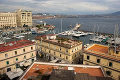 NAPLES, ITALY - OCTOBER 31, 2015: Air view of the old historical buildings of Naples with a recreation area on the roof. Air view of the old historical royalty free stock photo