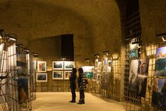 NAPLES, ITALY - OCTOBER 31, 2015: Local photo exhibition in the medieval castle Castel dell Ovo. Local photo exhibition in the medieval castle Castel dell Ovo royalty free stock images
