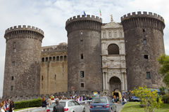 NAPLES, ITALY - SEPTEMBER, 2010: tourists visit the Castel Nuovo, residence of the medieval kings of Naples on september 21, 2010 Stock Photos