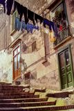 NAPLES, ITALY, 1979 - A typical Naples street with clothes hanging out to dry between the houses stock photo