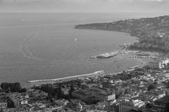Naples and Mediterranean sea bay with boats top view black and white. Naples seashore. Travel concept. Aerial italian landscape. Neapol panorama monochrome royalty free stock image