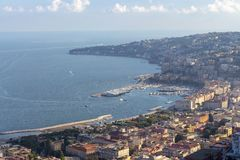 Naples and Mediterranean sea bay with boats top view. Naples seashore. Travel concept. Aerial italian landscape. Neapol panorama. Vastness and vacation concept stock photography
