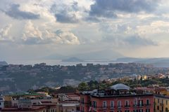 Naples and Mediterranean sea with islands and beautiful cloudy sky. Naples seashore on sunset. Travel concept. Aerial italian landscape. Neapol panorama stock photography