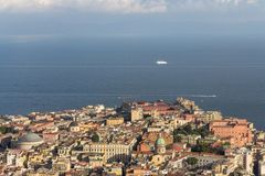 Naples and Mediterranean sea with white boat and ferry top view. Naples seashore on sunset. Travel concept. Aerial italian landscape. Neapol panorama. Vastness stock images
