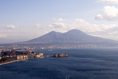 Naples And Mt. Vesuvius. From the perspective of the water, the view of the shore line of Naples, Italy, and Mt. Vesuvius in the distance stock images