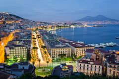 Naples by night, Gulf and Vesuvius on background. Naples, Campania, Italy. View of the bay by night and Mount Vesuvius Volcano in background royalty free stock photo