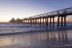 Naples Pier at sunset, Florida. Historic fishing pier in Naples at sunset. Florida, United States Stock Photos
