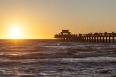 Naples pier at sunset, Florida. Silhouette of the fishing pier in Naples at sunset. Florida, United States Royalty Free Stock Photo