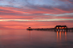 Naples Pier at sunset, Gulf of Mexico, USA Royalty Free Stock Images