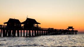 Naples pir på solnedgången Fotografering för Bildbyråer