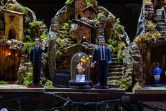 Naples, San Gregorio Armeno, political satire in a Neapolitan Presepe.Typical Christmas decorations stock image