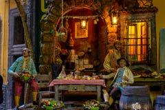 Naples, San Gregorio Armeno, scena przedstawia bankiet w Neapolitan ściąga zdjęcia stock