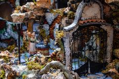 Naples, San Gregorio Armeno, scene with a gate behind a well. The Neapolitan Presepe.Typical Christmas decorations royalty free stock image
