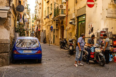 Naples street life. Street life in Naples, men talking in the streets. Italy Royalty Free Stock Image