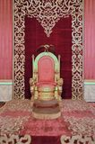 Naples` 16th century royal palace throne room. Lavish lavish interior detail in red gold and gilt in the throne room at Naples palazzo reale or royal palace from royalty free stock images